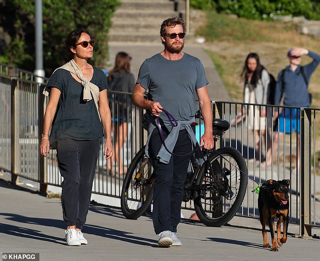 Matching: The duo wore near-matching casual ensembles - keeping cosy in track pants and T-shirts