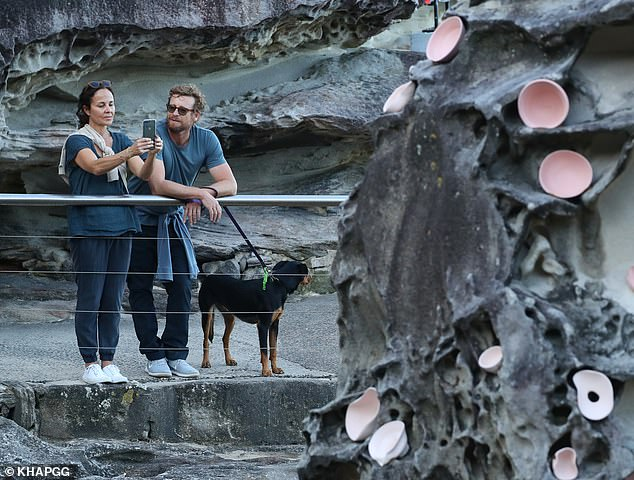 Making memories: Actress Rebecca snapped away with her iPhone as the couple viewed several stunning sculptures