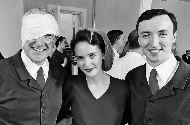 Dressed as her alter-ego Lois Bennett, who sings for the troops in the World War II drama, Julia posed between them — her father with a bandaged head, and her brother, who is a lawyer in real life, sporting a suit