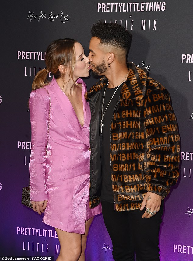 Sealed with the kiss: Emily looked lovely in a pink shirt dress as she gave her beau a kiss