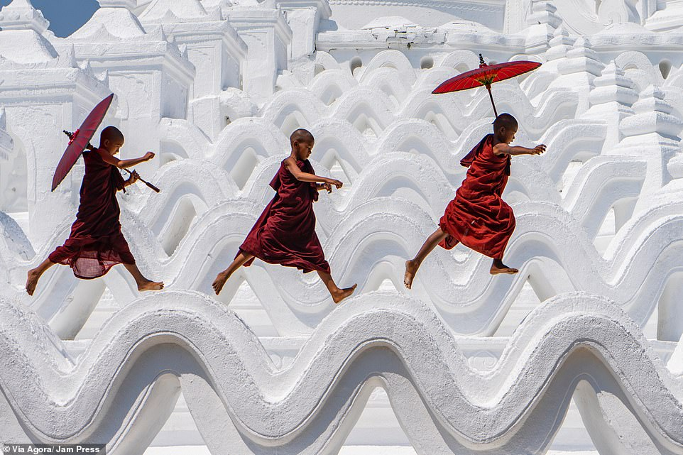 'Run and fun' photographed by Ling Ling: Three young monks have fun along the Hsinbyume Pagoda. She took the photograph in March 2019