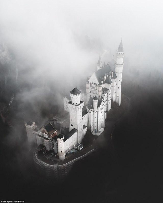 """""""Dark Disneyland"""" by Tommi Matz:Vertical panorama of the Neuschwanstein Castle"""
