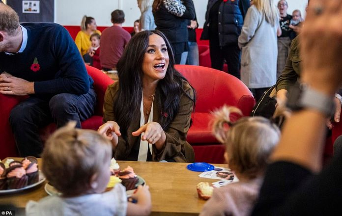 Meghan chatted to parents on the visit to the centre in Windsor yesterday about her son, who was six months old yesterday