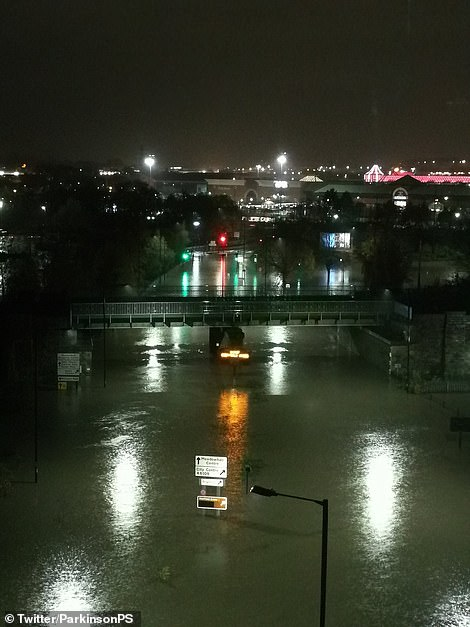 Hundreds of people were kept inside Meadowhall Shopping centre near Sheffield due to gridlocked traffic outside (pictured, flooding outside the shopping centre on Thursday evening)