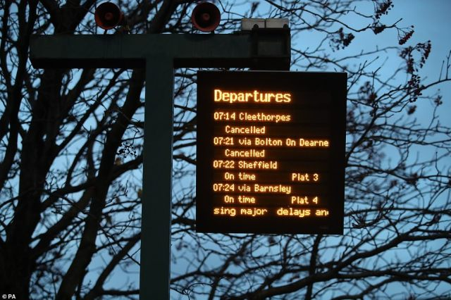 A sign shows cancelled trains at a station close to the Meadowhall shopping centre in Sheffield early this morning