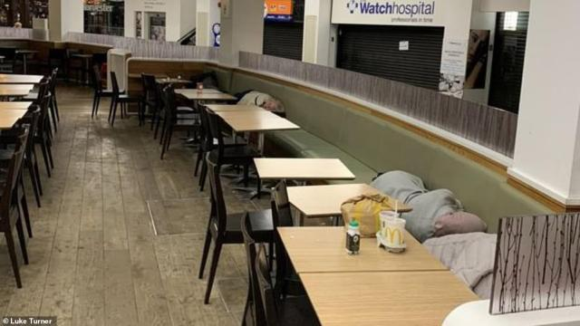 People are picture in sleeping bags overnight after the severe flooding surrounded Meadowhall shopping centre in Sheffield