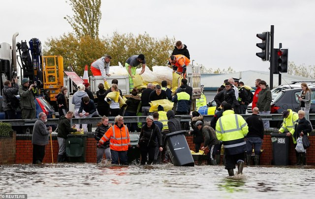 Sandbags arrive in a badly flooded area of Bentley, north of Doncaster, in South Yorkshire this afternoon
