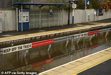 Flood water covers the rail tracks at Rotherham Central station