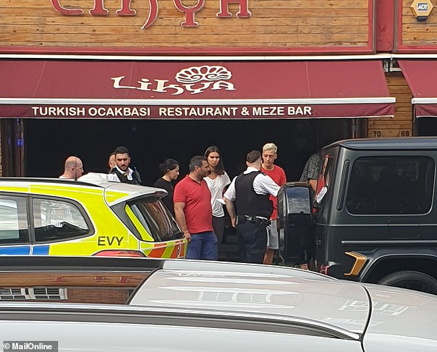 Mesut Ozil (dyed blonde hair) was pictured talking to officers outside Turkish restaurant Likya on Golders Green Road in north London after the attack this summer