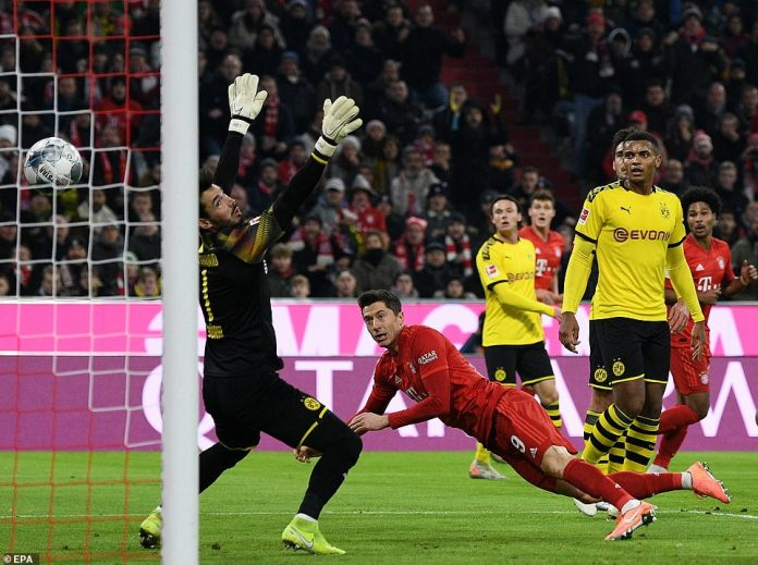 Robert Lewandowski opened the scoring against his former side by heading home Benjamin Pavard's cross past Roman Burki