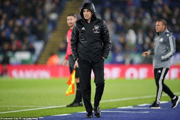 Manager Emery watched on from the sidelines as the rain hammered down on his miserable 50th game in charge of Arsenal