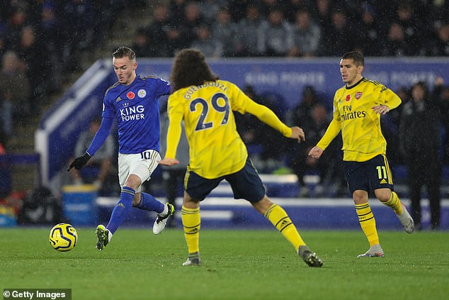 He has a pop at goal in the clash against the north Londoners under pressure from Guendouzi