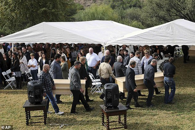 The men carry the remains of Dawna Langford and her two sons, Trevor and Rogan, before their burial at the La Mora cemetery on Thursday.