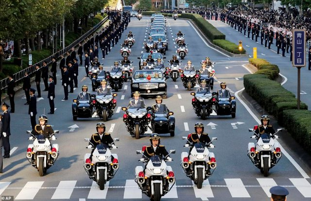 The royal motorcade drove through a street in Tokyo under tight security for the marking of Naruhito's enthronement, with police setting up 40 checkpoints leading to the area, on November 10