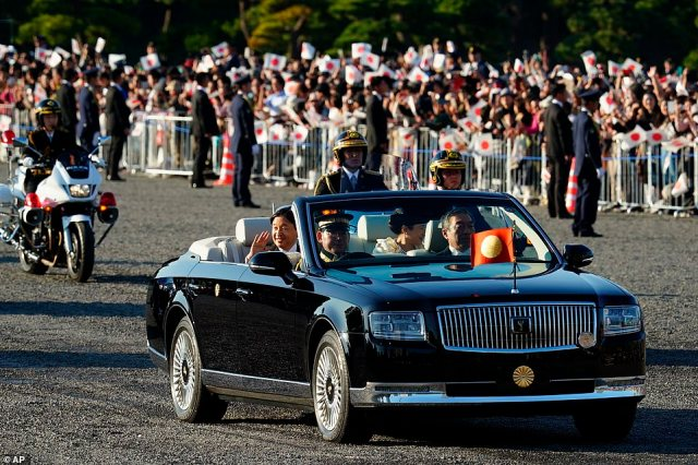 Naruhito (pictured) is warmly welcomes by the public and polls show support for the royal family has increased over the past three decades because of his parents' effort to bring what used to be the aloof palace closer to the people
