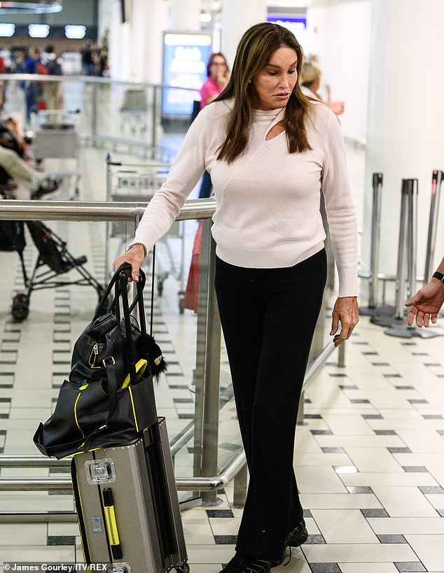 Nail the airport chic: the former Olympian opted for a white sweater and wide pants for a long flight