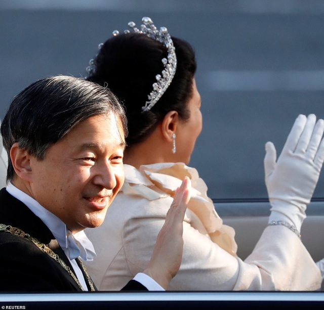 The parade marks his enthronement, a day after people showed their congratulations with music and dance performances, including the song 'Ray of Water' performed by the hugely popular Japanese male pop group Arashi, in Tokyo