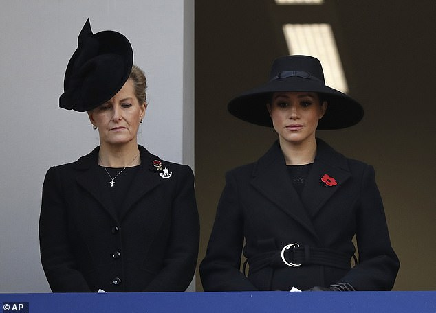 Sarah Ferguson opted for a black hat and a big fascinator as she joined Meghan on the balcony