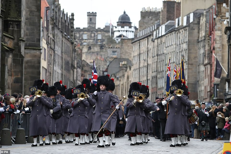The military band play as they march down Cockburn Street before the start of a Remembrance Day service at the Stone of Remembrance in Edinburgh