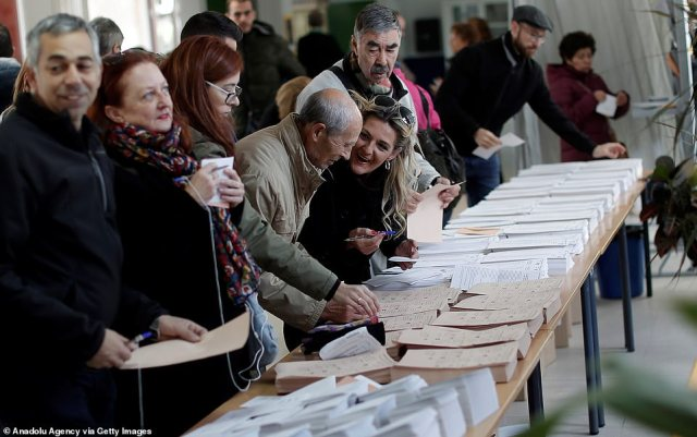 Spanish citizens cast their votes in Madrid, Spain, today. The last election had a record turnout of 76 per cent, but the turnout for this election is expected to be lower as voters suffer from fatigue