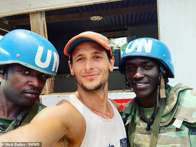 Nick poses for a photo in a UN compound in Somalia during his travels which saw him get throughten passports. He got 201 flights covering 13,500 miles between countries, along with 45 train journeys, 15 buses and 280 taxis, on his adventure