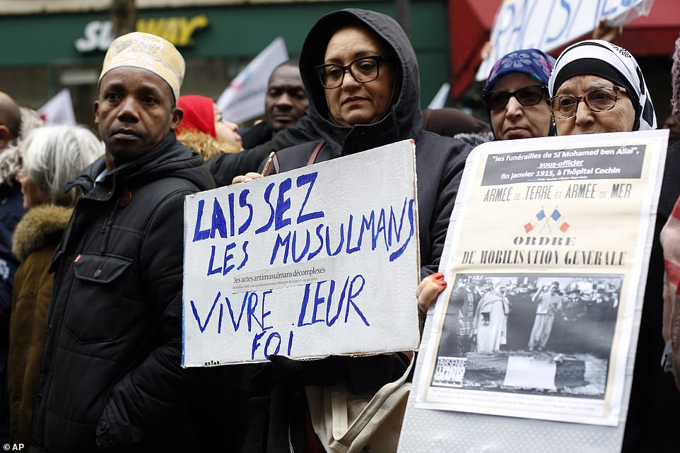 The state secretary in charge of fighting discrimination Marlene Schiappa had said the demonstration was a protest against secularism 'under the disguise of fighting discrimination'. Pictured:Placard on the left reads: 'Let Muslims live their faith'