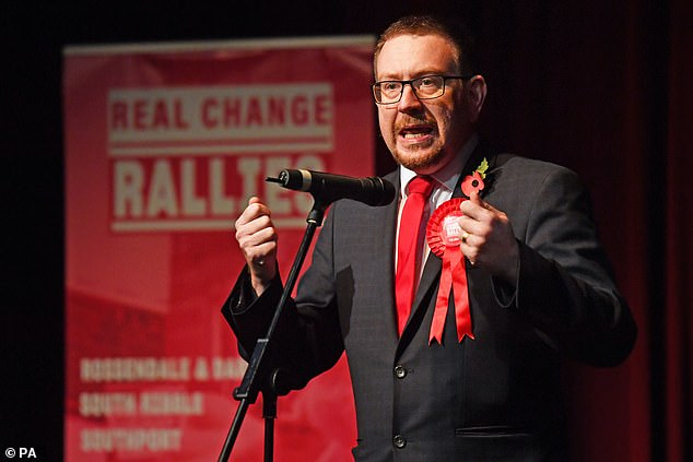 Andrew Gwynne (pictured) said Labour would seek to negotiate 'bespoke reciprocal arrangements' that would allow people to continue travelling freely between Britain and the EU