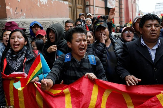 People protest against Bolivia's now former President Evo Morales in La Paz on Sunday