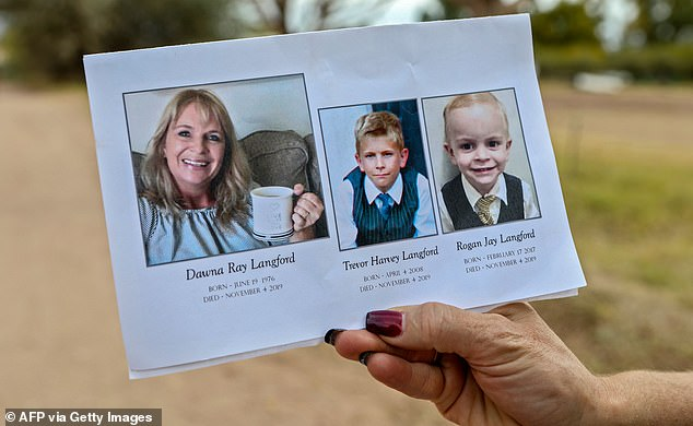 A mourner holds a rememberance card at the funeral ceremony for Dawna Ray Langford, 43, and her sons Trevor and Rogan, who were among nine victims killed