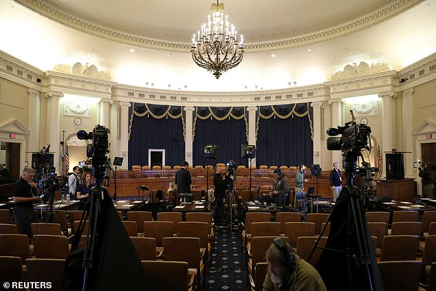 Television news crews are photographed to be put in place before televised dismissal hearings