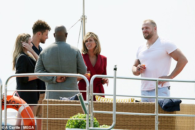 Greetings: Kate mingled with her fellow campmates James, Myles, Ian and Myles as they sipped welcome flutes of drinks
