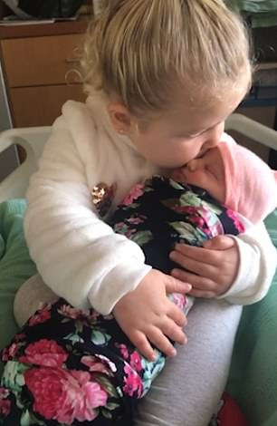 Molly offers her new sister multiple kisses
