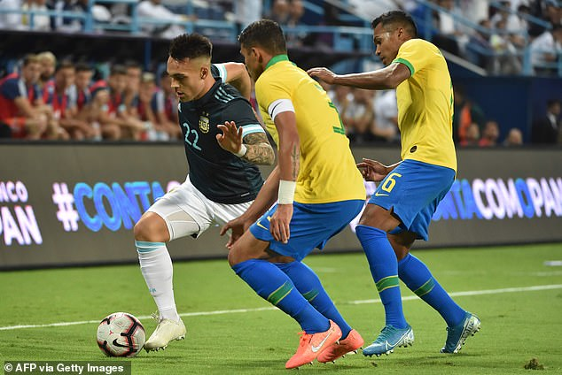 Lautaro Martinez (left) is watched carefully by Brazil captain Thiago Silva and Alex Sandro
