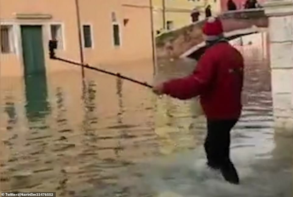 The tourist could be seen in footage posted on social media armed with a selfie stick and walking confidently towards his destination, before dropping into the canal as the floodwater suddenly got deeper