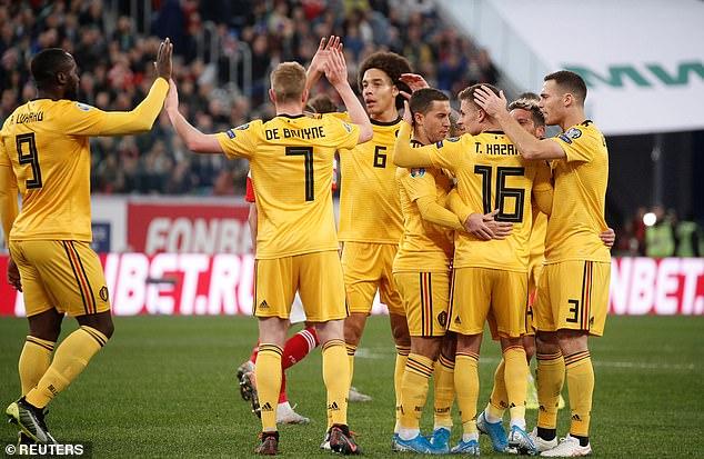 The Belgium players congratulate Thorgan Hazard after he scored their opening goal
