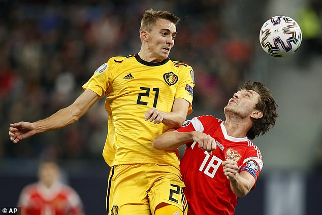 Belgium's Timothy Castagne battles for possession with Yuri Zhirkov of Russia