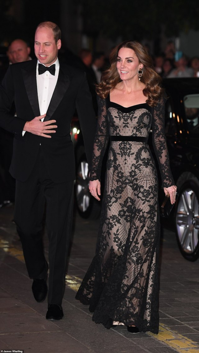 Kate looked stunning in a floor-length black lace overlay Alexander McQueen gown and wore her glossy locks in loose curls while Wills donned a stylish tux