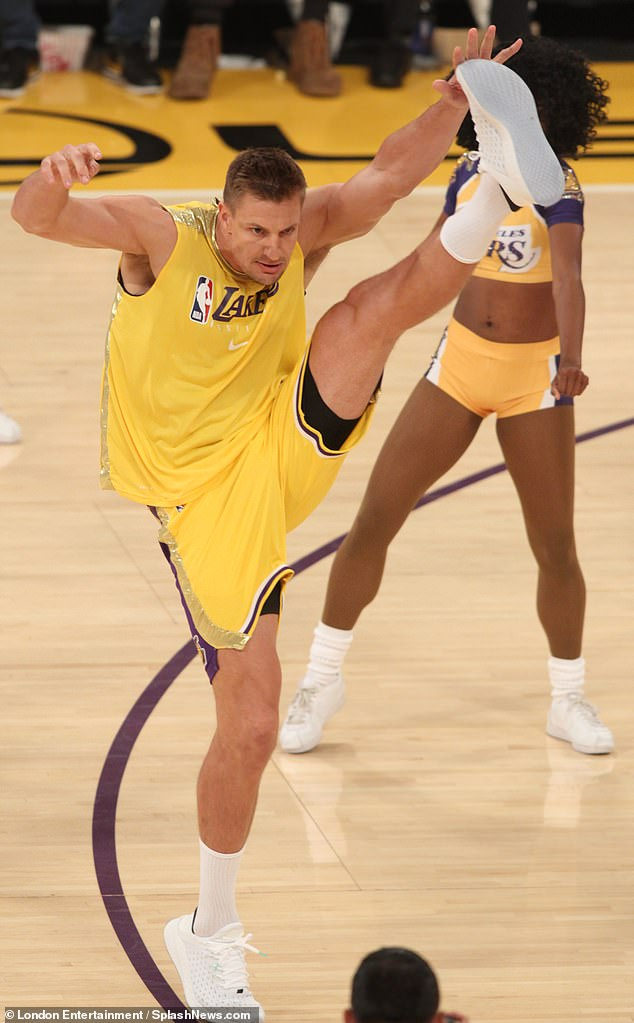 Concentration:Wearing a yellow Lakers jersey, the 6ft6in Gronkowski made a creditable effort to keep up with the dance routine as Laker Girl regulars performed around him