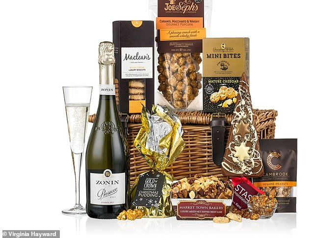 Packed with a Christmas pudding, wrapped in gold, a bottle of prosecco and fancy sweets bits, including a chocolate tree lolly - it looks like it costs more than it actually does
