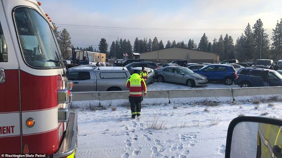 The slippery roads caused a more than 60-car pileup along Interstate 90 near Spokane, Washington (pictured on Tuesday)