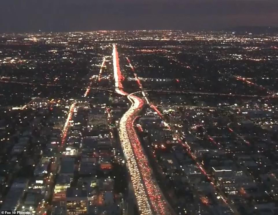 Travelers try to escape LA Tuesday night as this aerial image shows bumper-to-bumper traffic on a jam-packed highway
