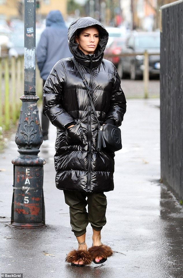 Style: The glamour model also sported a pair of dark green trousers and a pair of open-toed shoes with a faux-fur detail