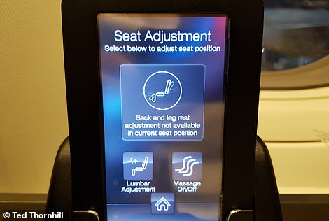 The seat position is controlled by this intuitive handset, which has pre-seat options for 'take-off/landing', 'desk', 'movie', 'relax', 'bed' and 'dine'