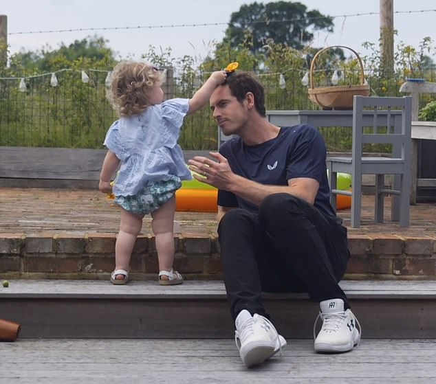 Andy Murrey plays with his daughter in their garden.The documentary for Amazon Prime Video, titled Andy Murray: Resurfacing, was released on Friday