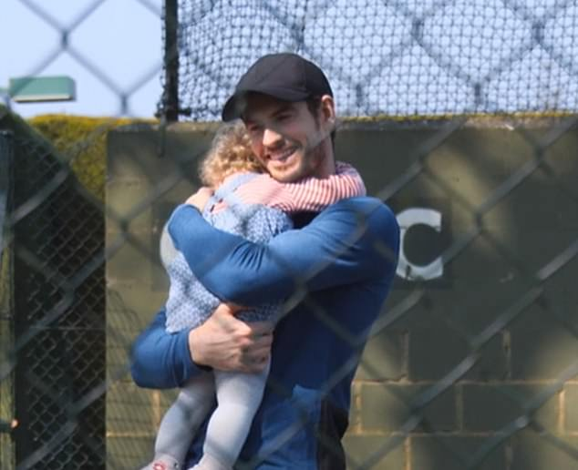 Doting father: a cuddle for one of his girls.As well as showing snippets of his family life, the film follows an emotional Murray before surgery and during his recovery