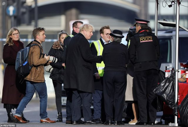 Boris Johnson talks to Cressida Dick and police officers at London Bridge, the day after two people were killed in a horrific terrorist attack