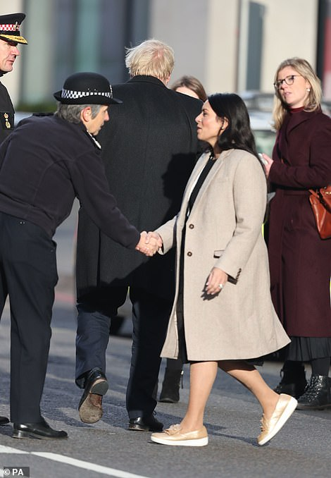 Metropolitan Police Commissioner, Cressida Dick, (left) and Home Secretary Priti Patel (centre) joined the PM