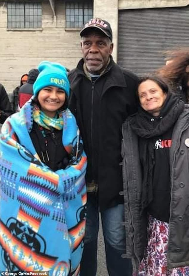 Actor Danny Glover, center, also appears to have been at the event over Thanksgiving
