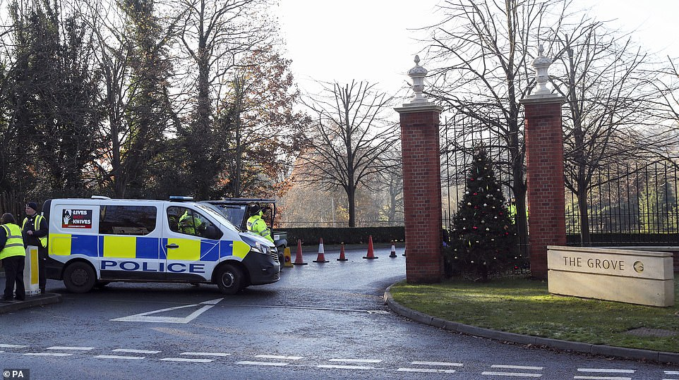 Police outside The Grove hotel near Watford in Hertfordshire today ahead of the Nato summit. Traffic cones were also in place