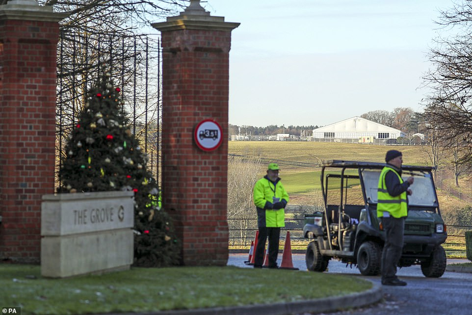 Security at The Grove in Hertfordshire today ahead of the Nato leaders' meeting this week. A festive Christmas tree is also seen at the entrance to the hotel
